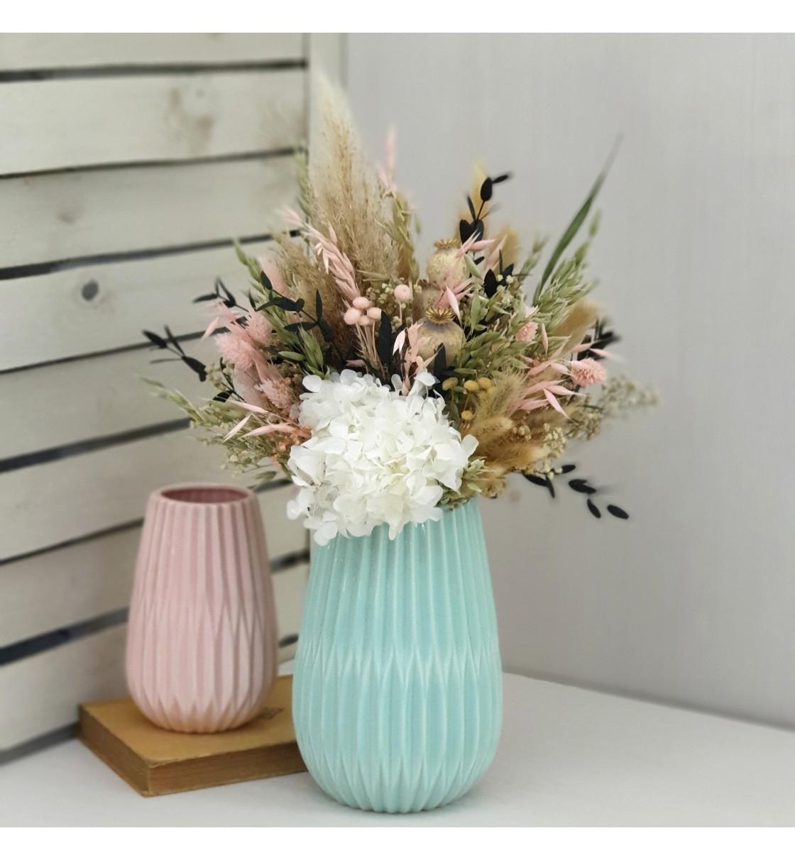 Centro flor seca y preservada tonos rosados base celeste
